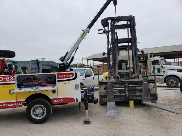 Hill Country Forklift work truck lifting heavy equipment